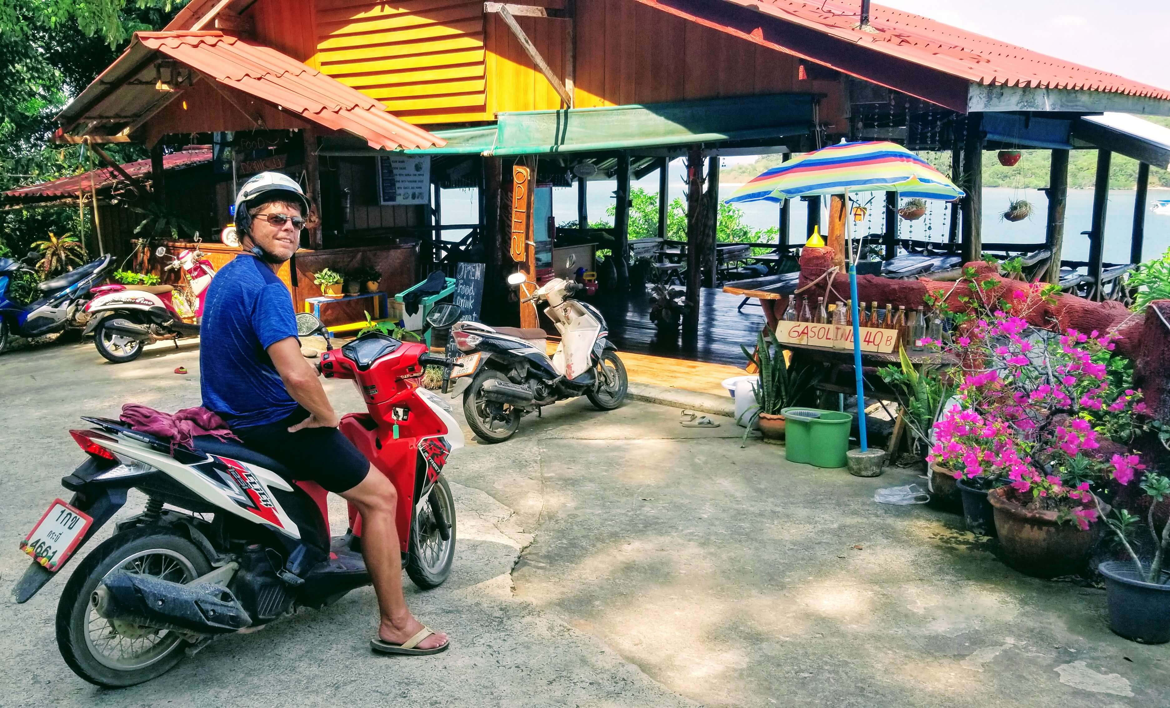 Rob on moped at a cafe overlooking Ko Por