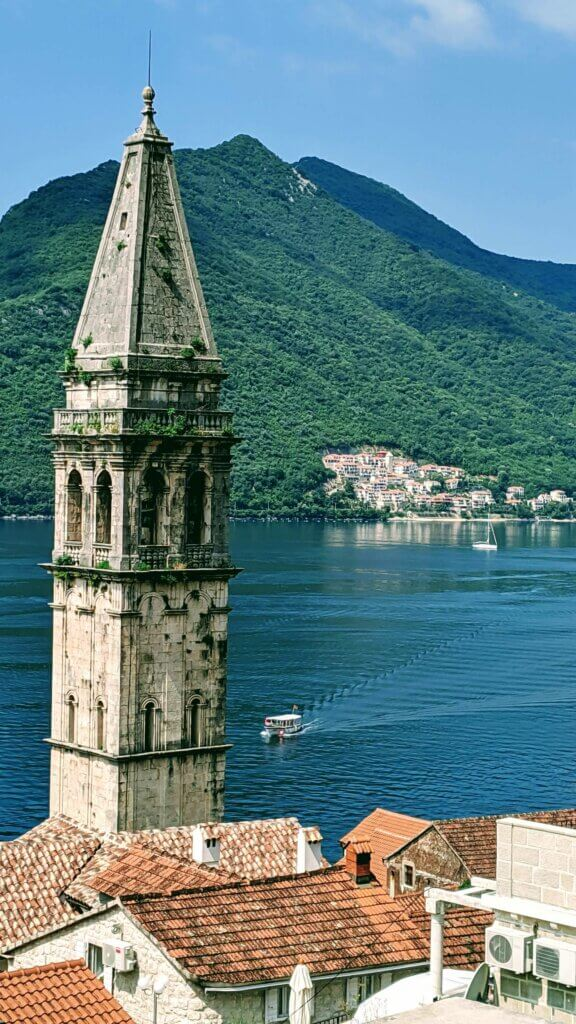 Things to see and do in Kotor: Perast with Our Lady of the Rocks and the Islet of the Dead in the distance