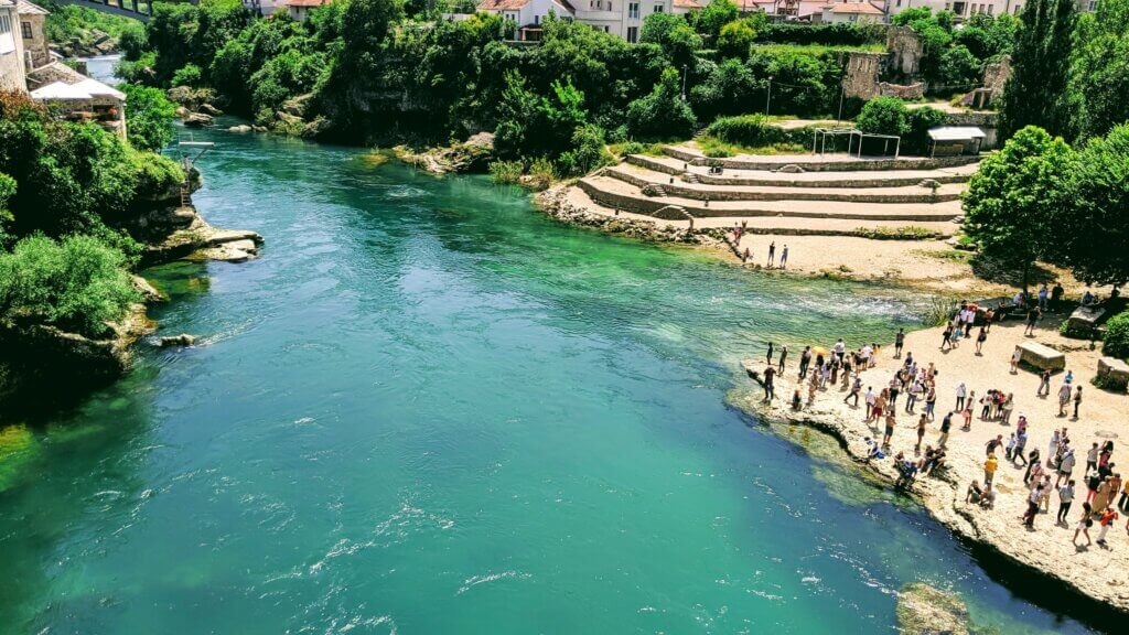 The tourquoise Neretva River below the Old Bridge is a great place to swim and spend a day in Mostar.