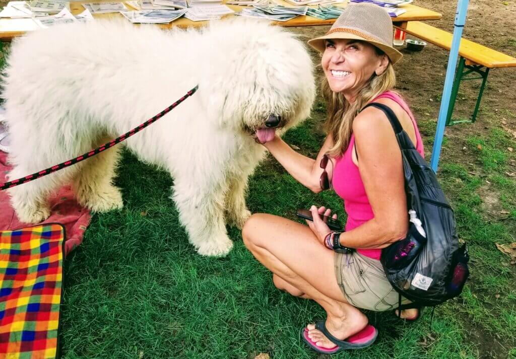 Masha petting a Hungarian Komodor dog